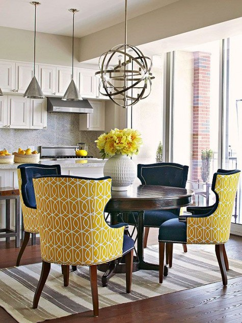chic wingback chairs with bright yellow printed backs and navy seats and fronts are a fresh take on traditional aesthetics