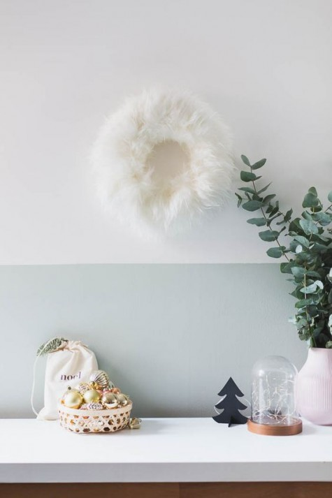 a faux sheepskin from IKEA can be turned into a cute and unusual holiday wreath with plenty of texture