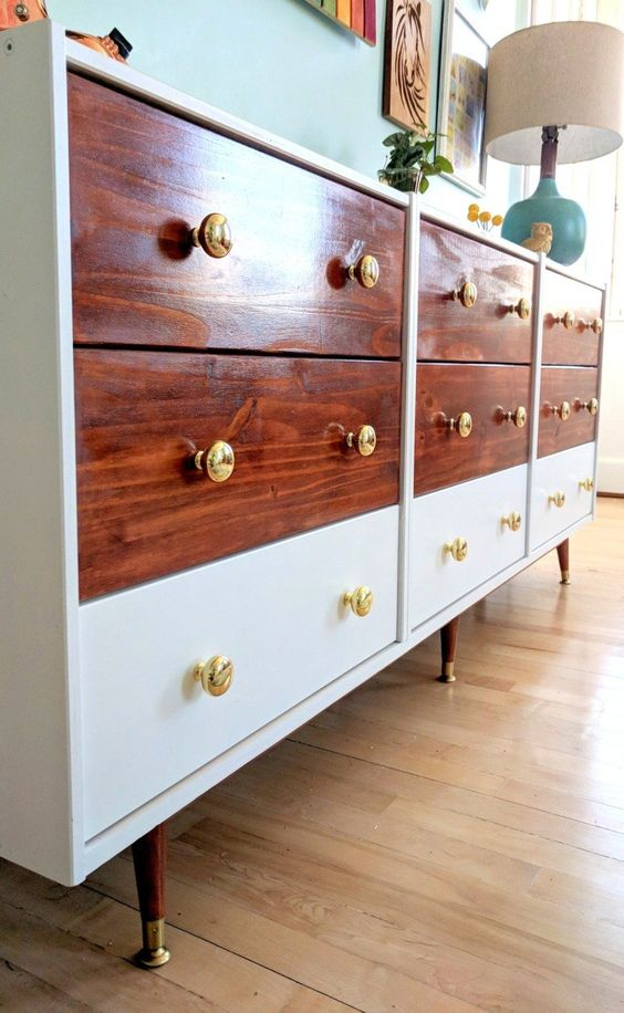 a triple IKEA Rast hack with rich colored stain and white parts plus elegant gold knobs for a mid-century modern space