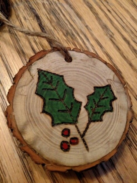 a wood burnt and painted mistletoe wood slice ornament will require some more effort but it's worth it