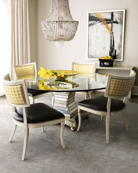 catchy chairs with black leather seats and yellow print backs plus a nail trim look contrasting and make the space wow