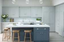 06 a dove grey kitchen, a slate blue kitchen island and white countertops that match to create a more unified space