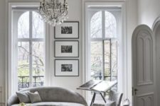 06 a white Parisian living room with molding, a crystal chandelier, marleized furniture and much natural light