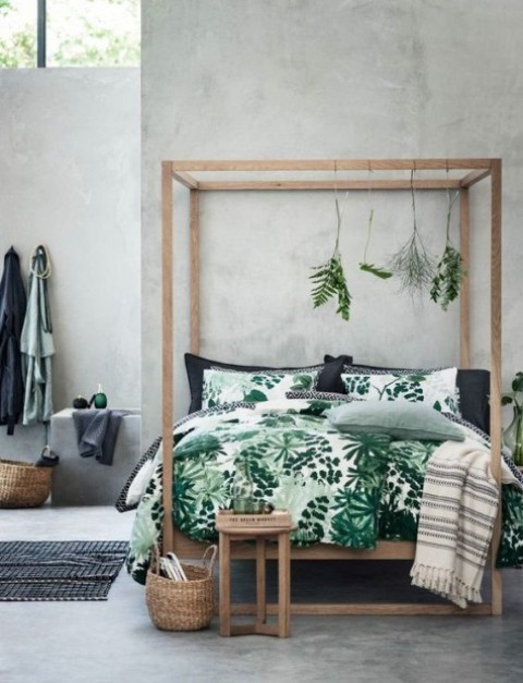 an industrial meets minimalist bedroom is infused with botanical prints through bedding that make it lively and fresh
