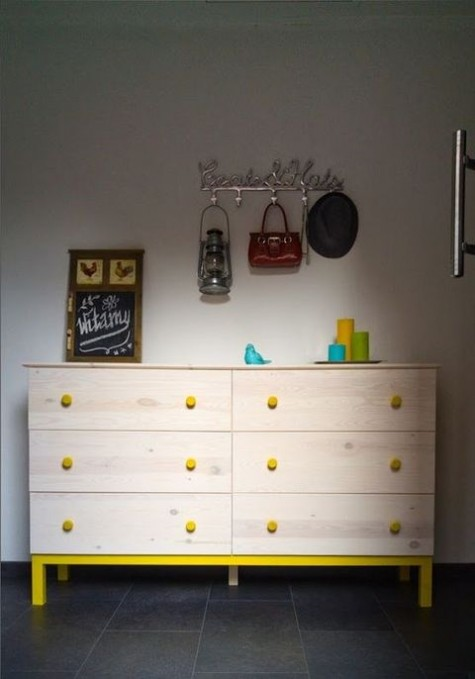 a light-colored double Tarva dresser with yellow knobs, framing and legs is a fun idea with a touch of color and is easy to realize