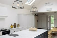 07 a pure white space and a navy kitchen island, white stone countertops everywhere for a cohesive space