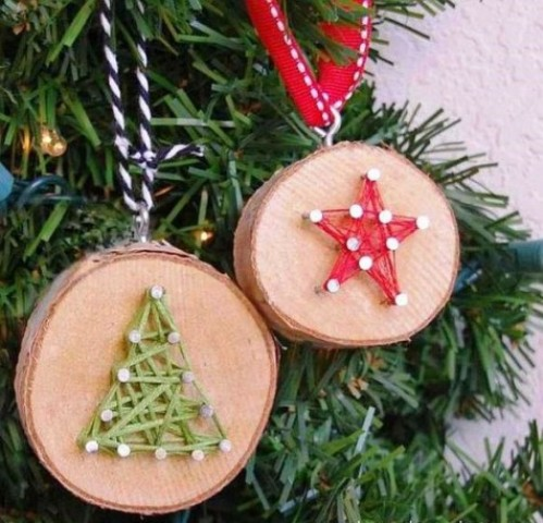 wood slice Christmas ornaments with string art decor, which is a hot trend right now