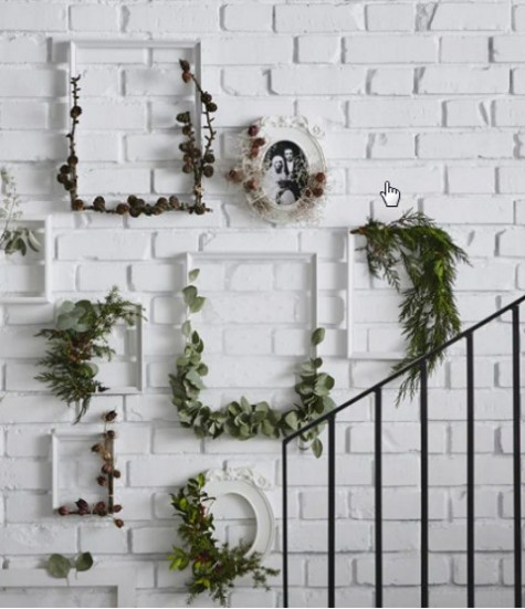 KNOPPANG frames wrapped with greenery and pinecones will be a nice alternative to a usual Christmas wreath