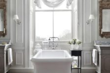 08 a beautiful vintage-inspired bathroom with a white tub, curtain, mirrors and chic vanities plus a rug