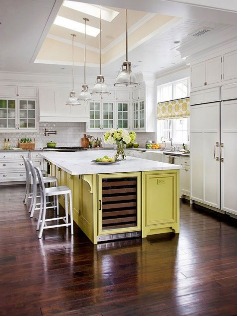 a modern farmhouse kitchen in white and a yellow kitchen island and yellow printed curtains for a touch of color
