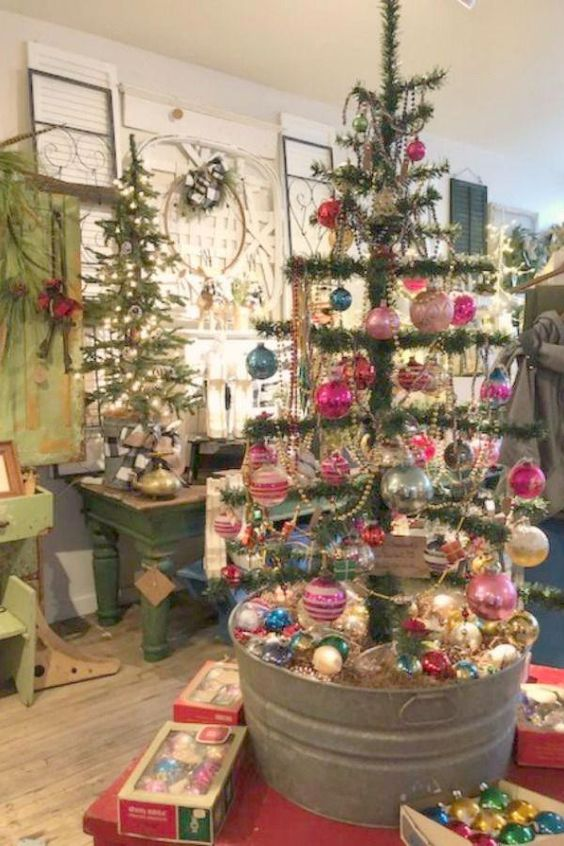vintage trees in galvanized buckets with bright and pastel vintage ornaments and bead garlands plus lights for a bold shabby chic space