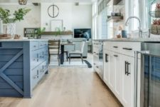 09 a modern farmhouse white kitchen and a bright blue kitchen island with matching grey stone countertops
