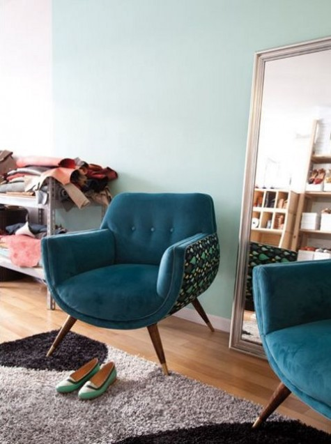 a rounded chair with teal upholstery and a printed curved base will catch an eye with its shapes and with its colors