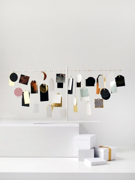 an ultra-modern advent calendar of IKEA Vinter decoration stand and colorful labels is a cool idea for a modern space