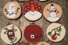 09 various painted wood slice ornaments that include snowmen, stockings, deer and trees feel and look very vintage-like