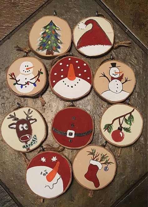 various painted wood slice ornaments that include snowmen, stockings, deer and trees feel and look very vintage-like