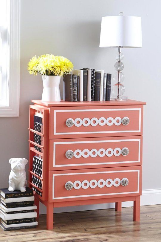 a coral Tarva hack with white inlays, glass knobs and a side magazine or book holder that makes it even more functional