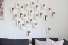 11 IKEA VINTER gift bags, SYRLIG curtain rings, GIVANDE gift tags to make a modern wall-mounted advent calendar