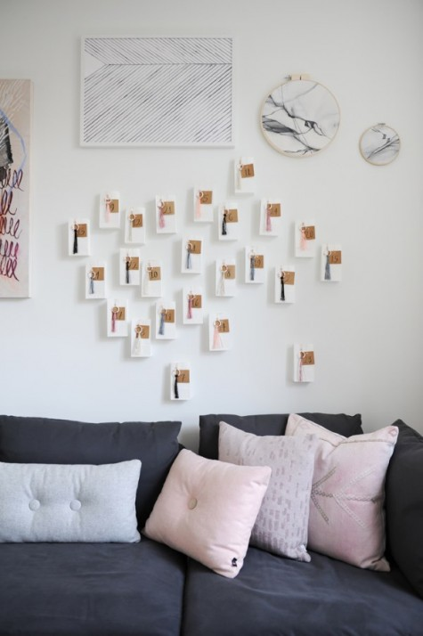 IKEA VINTER gift bags, SYRLIG curtain rings, GIVANDE gift tags to make a modern wall-mounted advent calendar
