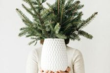 11 a minimalist Christmas centerpiece of a white vase and evergreens is easy to compose yourself
