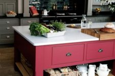 11 a vintage rustic kitchen in grey and an oversized bright pink kitchen island with plenty of closed and open storage