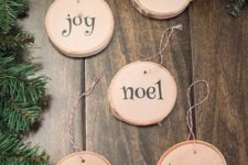 11 cute printed wood slice ornaments with cute letters are easy to DIY, add yarn and hang them to the tree