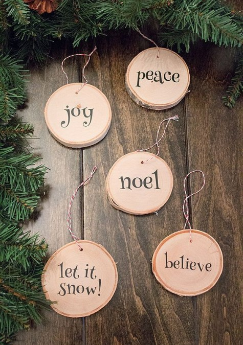 cute printed wood slice ornaments with cute letters are easy to DIY, add yarn and hang them to the tree