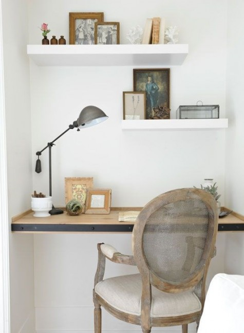 a built-in wooden desk with some thick floating shelves over it plus a refined vintage chair