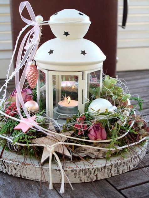 a holiday decoration of IKEA ROTERA lantern, a wood slice and some pretty ornaments can be used as a pretty centerpiece