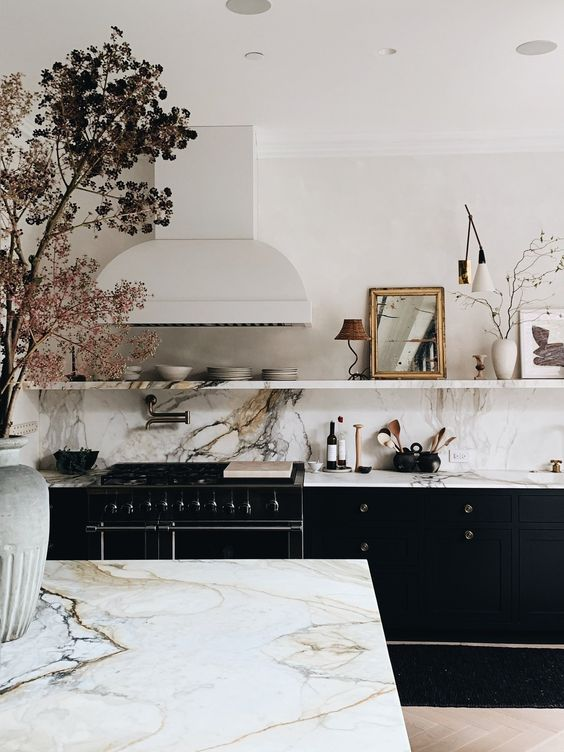 a natural way to add pattern and print to your space - go for a marble or stone countertop and backsplash in the kitchen