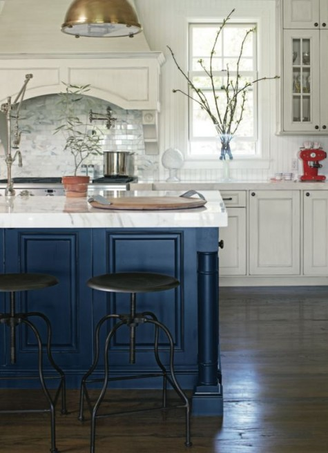 a white farmhouse kitchen with a metallic navy kitchen island and matching marble countertops everywhere