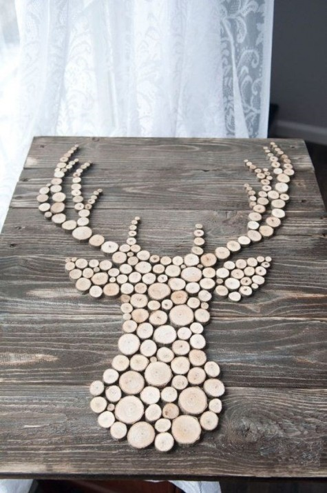 a chic rustic Christmas sign of wood slices showing a deer will be great for decorating your space in fall and winter