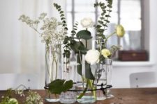 13 a pretty holiday centerpiece of CYLINDER vase, FRASERA whisky glass, STOCKHOLM carafe and fresh blooms and greenery