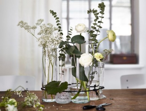 a pretty holiday centerpiece of CYLINDER vase, FRASERA whisky glass, STOCKHOLM carafe and fresh blooms and greenery