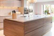 13 neutral glam kitchen with a wood clad kitchen island to add coziness and warmth to the neutral space