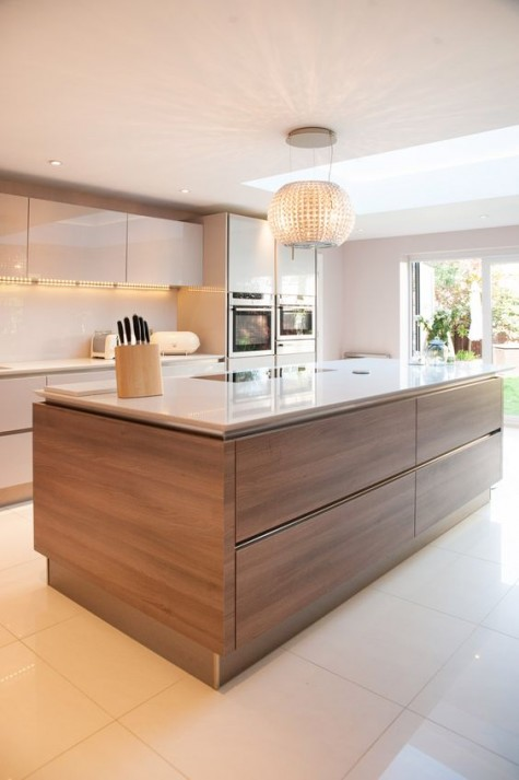 neutral glam kitchen with a wood clad kitchen island to add coziness and warmth to the neutral space