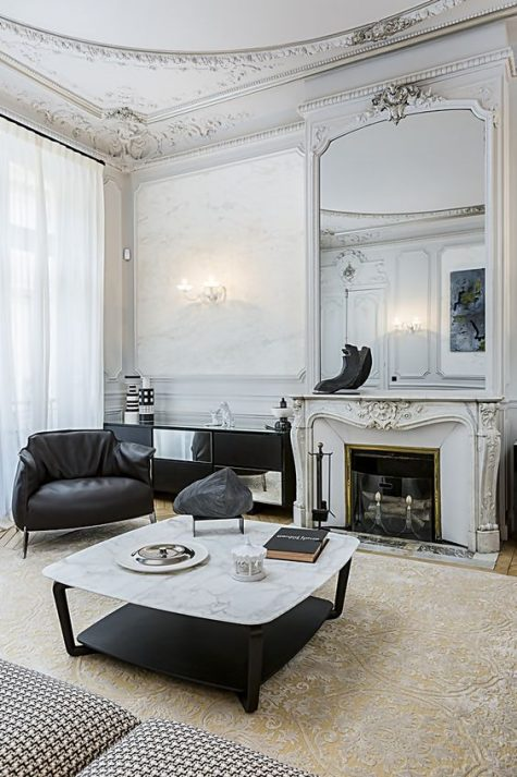 sophisticated molding on the walls, ceiling and fireplace make the space super refined and wow