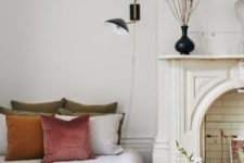 14 a beautiful Parisian bedroom with a faux fireplace with a gorgeous mantel and some white subway tiles inside