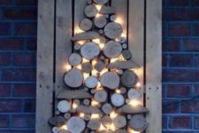 14 a cool and rustic Christmas sign of wood slices and wood pieces with lights is ideal for indoors and outdoors, too