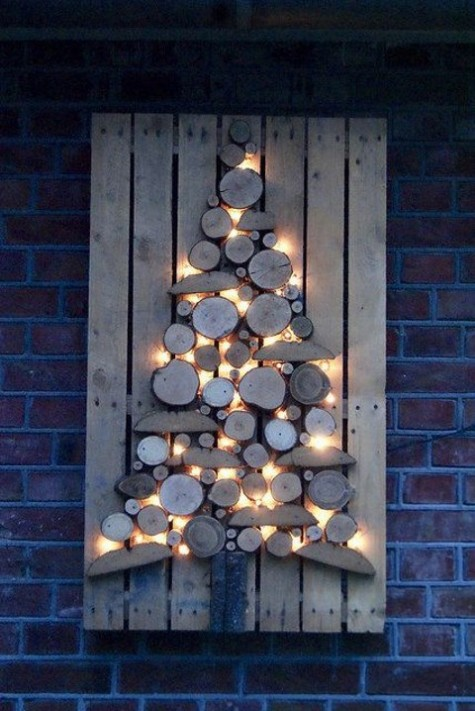 a cool and rustic Christmas sign of wood slices and wood pieces with lights is ideal for indoors and outdoors, too