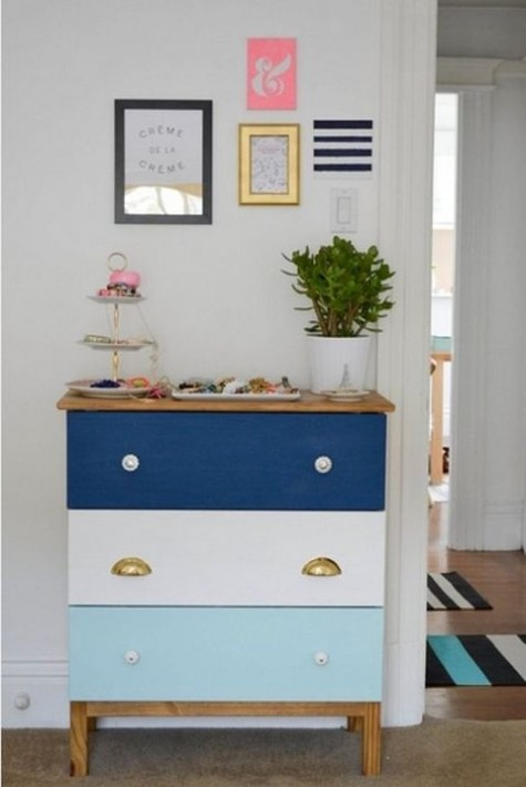 a striped blue and white Tarva dresser with mismatching knobs is great for a beach or coastal space