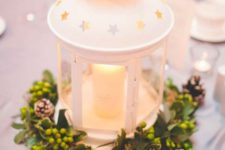 14 a super cozy Christmas centerpiece made of IKEA ROTERA lantern and some evergreens and snowy pinecones can be even used at weddings