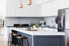 14 a white kitchen with a navy kitchen island and black and white countertops for more contrast