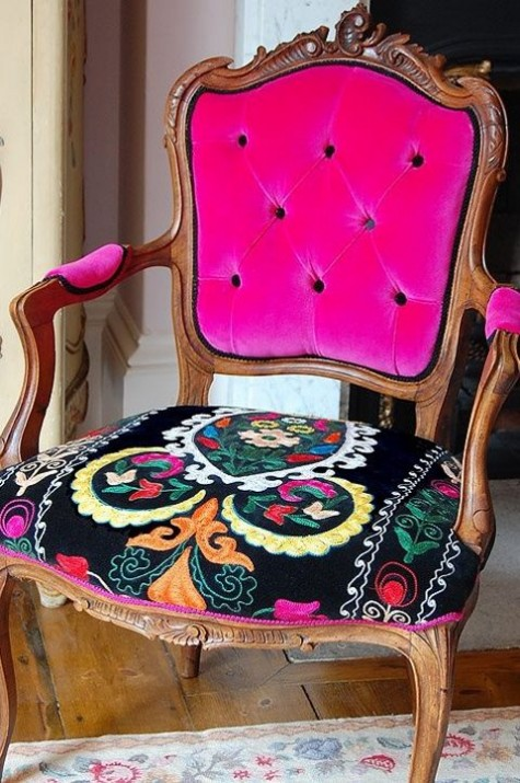 a gorgeous vintage chair with a bright embroidered seat and bright pink velvet back plus armrests will make a refined statement