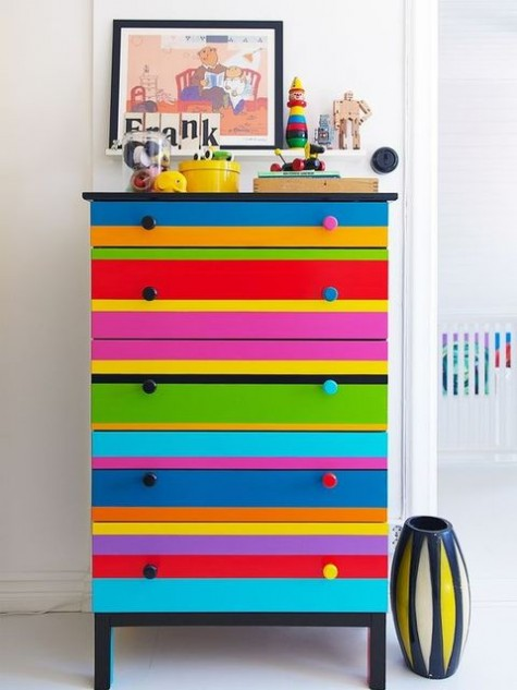a super colorful and bright striped Tarva dresser with bold knobs is a fantastic idea for adding color