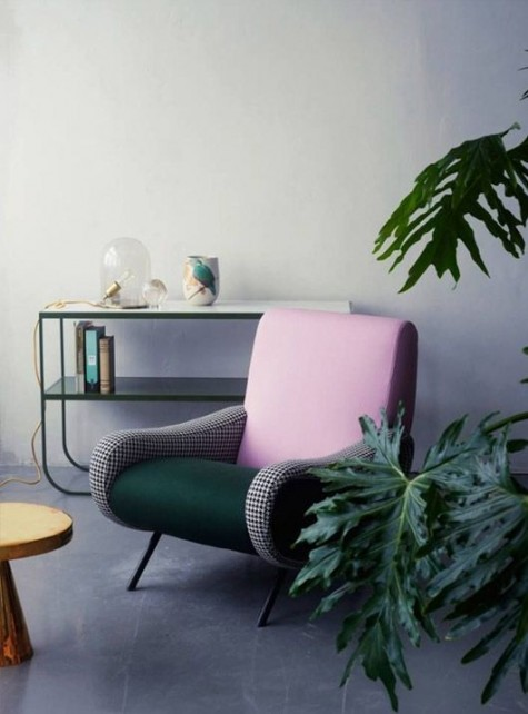 a mid-century modern chair with a pink back, a forest green seat and gingham armrests looks catchy yet not too much