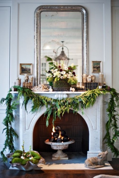 an evergreen garland to decorate the fireplace and make it look very Christmassy