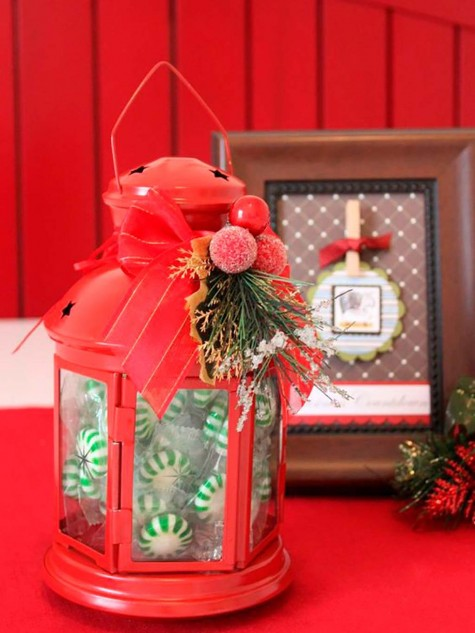 fill an IKEA ROTERA lantern with peppermint candies and decorate it with fake berries and evergreens