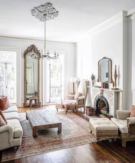 this gorgeous ornate fireplace takes over the whole room and makes it very special and very refined