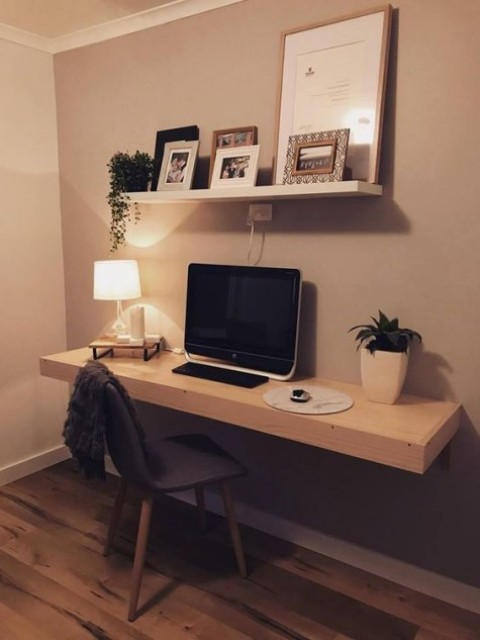 a floating shelf and a floating desk will make up a small yet comfy home office nook, add more light to brighten it up